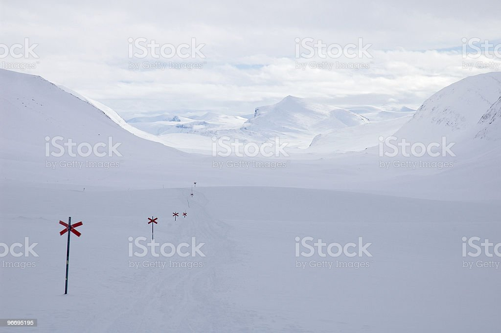 Cross country ski hiking trail Kungsleden with red crosses stock photo