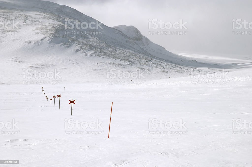 Cross country ski hiking trail with red crosses stock photo
