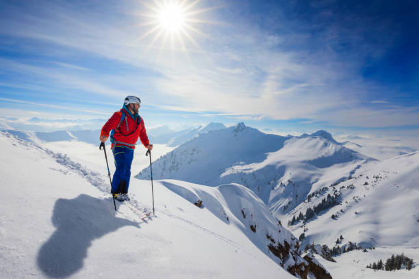 Cross country skiier - Ski touring in Alps stock photo