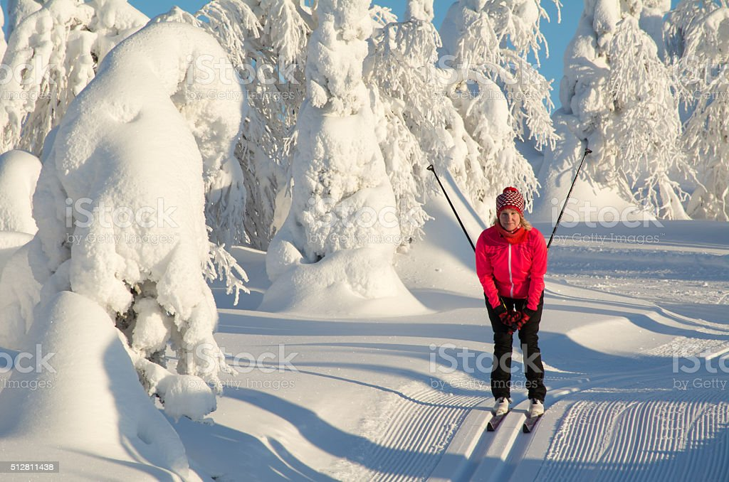 Cross country skiing on snowy mountain stock photo