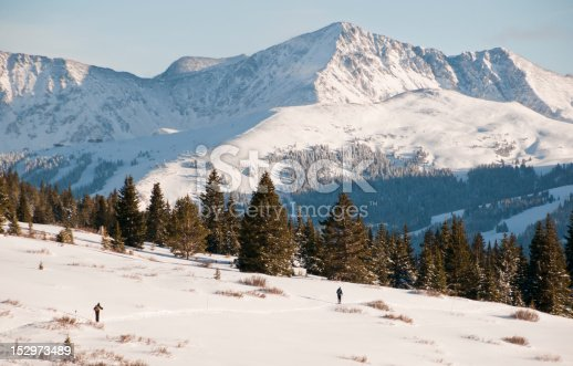A pair of cross country skiers travel through the Colorado back country.