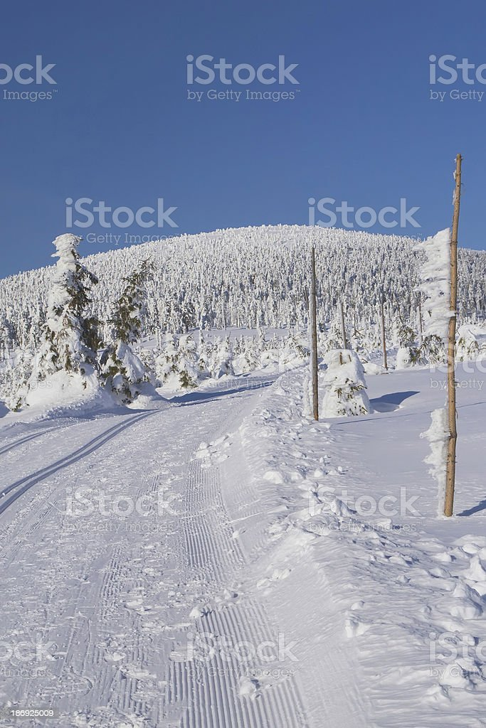 Cross country skiing way in the mountains stock photo