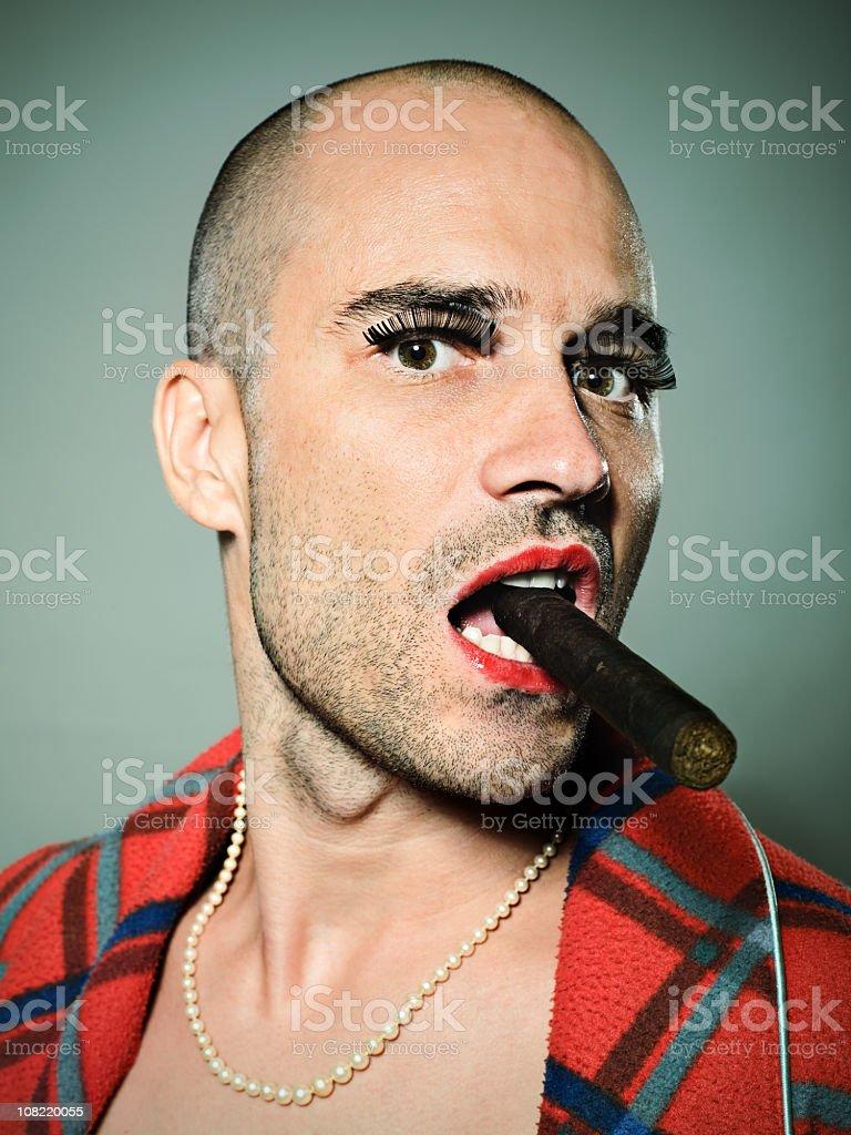 Cross Dressed Man Smoking Cigar royalty-free stock photo