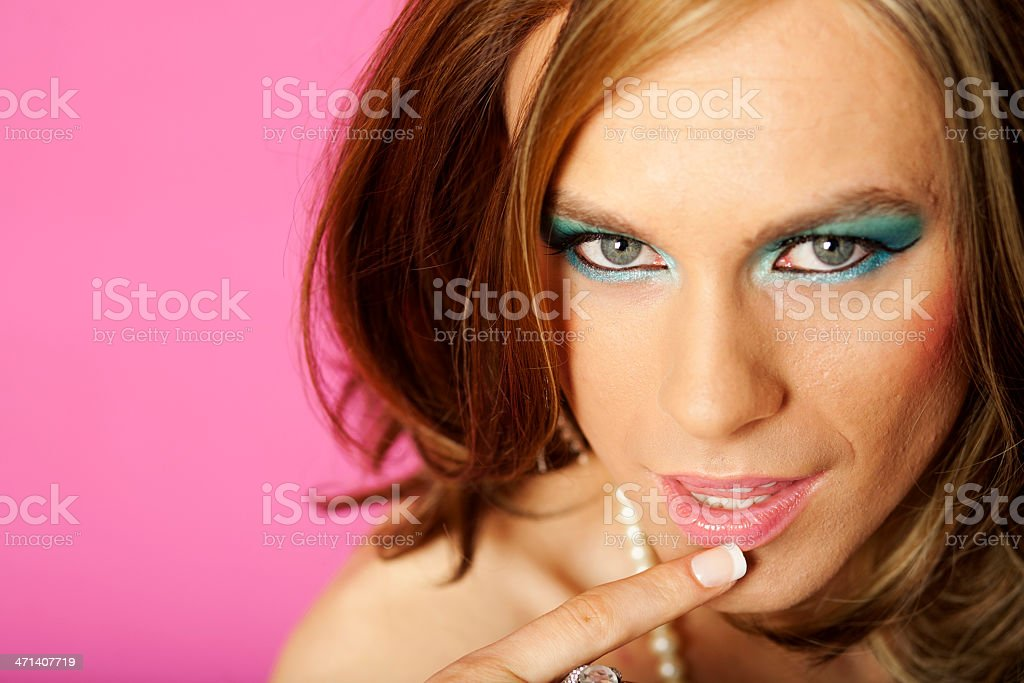 Cross dresser on pink stock photo