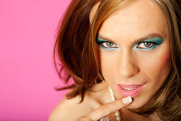 cross dresser on pink - transvestite stock photos and pictures