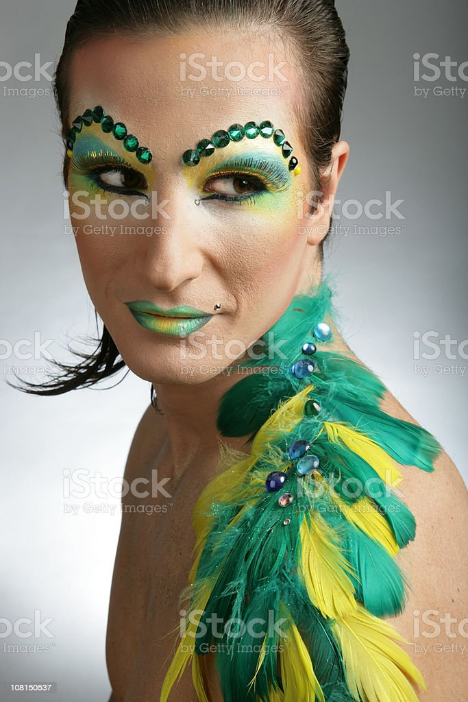 Cross Dressing Man Wearing Colorful Make-up and Feathers stock photo