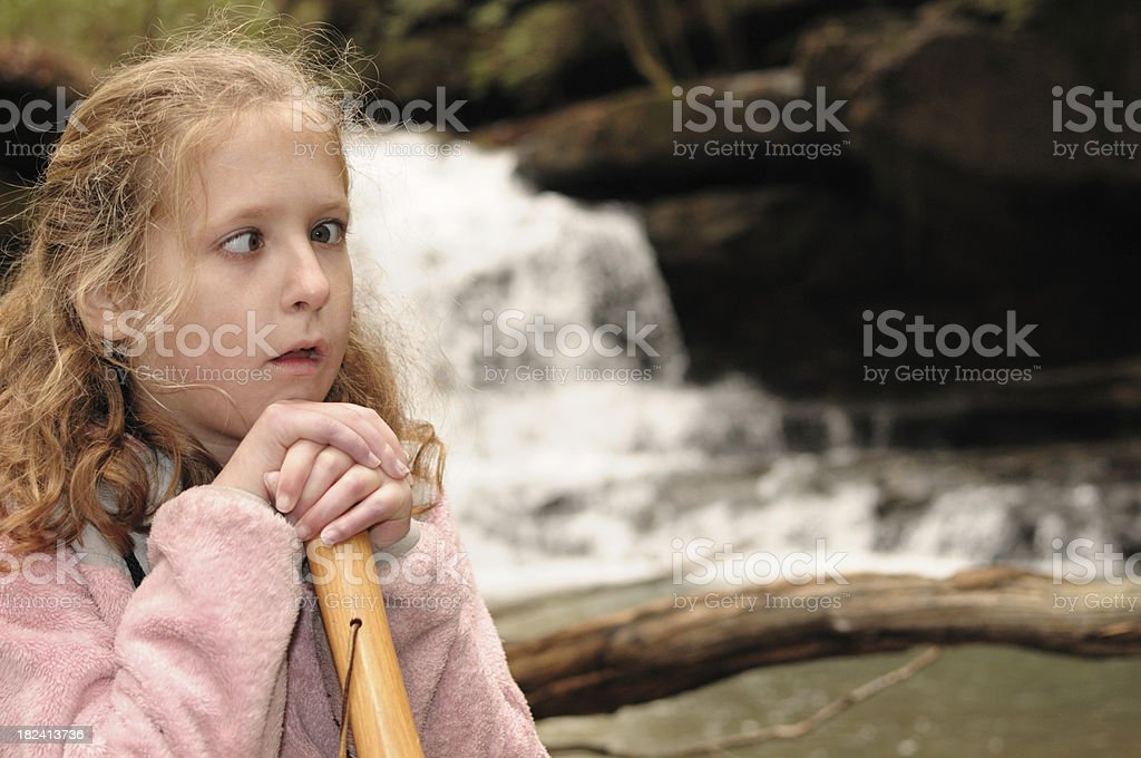 Cross eyed girl by waterfall royalty-free stock photo