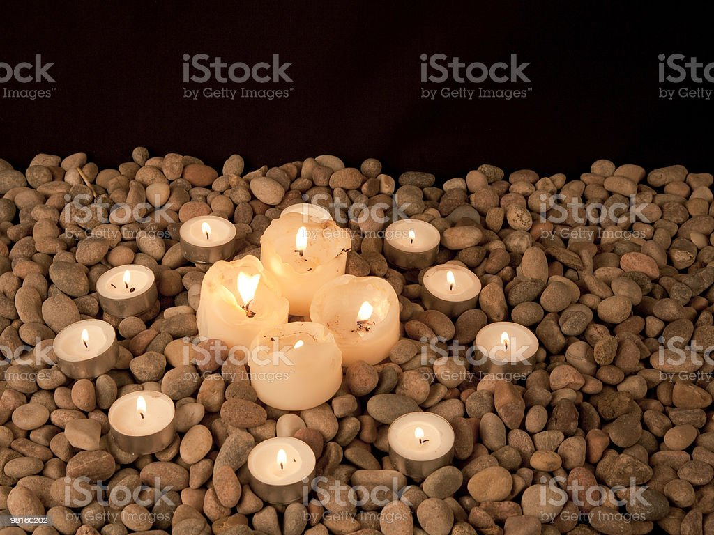 Cross formed from four candles surrounded by circle of nightlights royalty-free stock photo