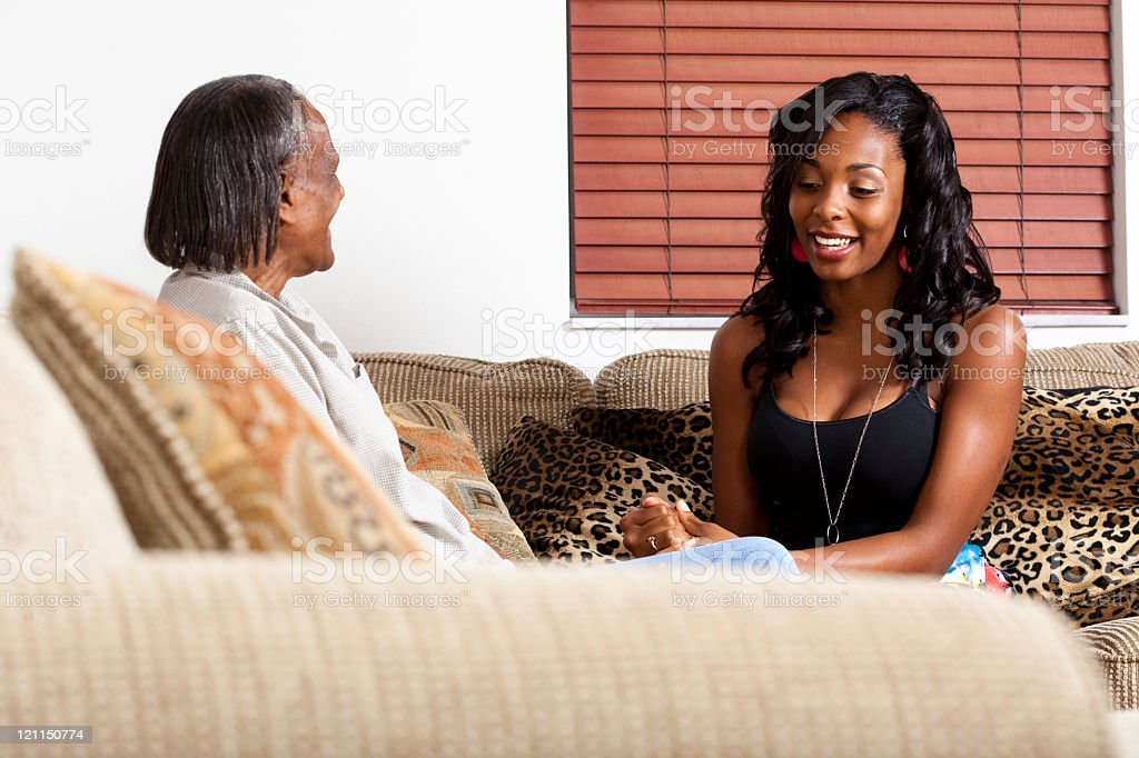 Cross generation talk between African Americans stock photo