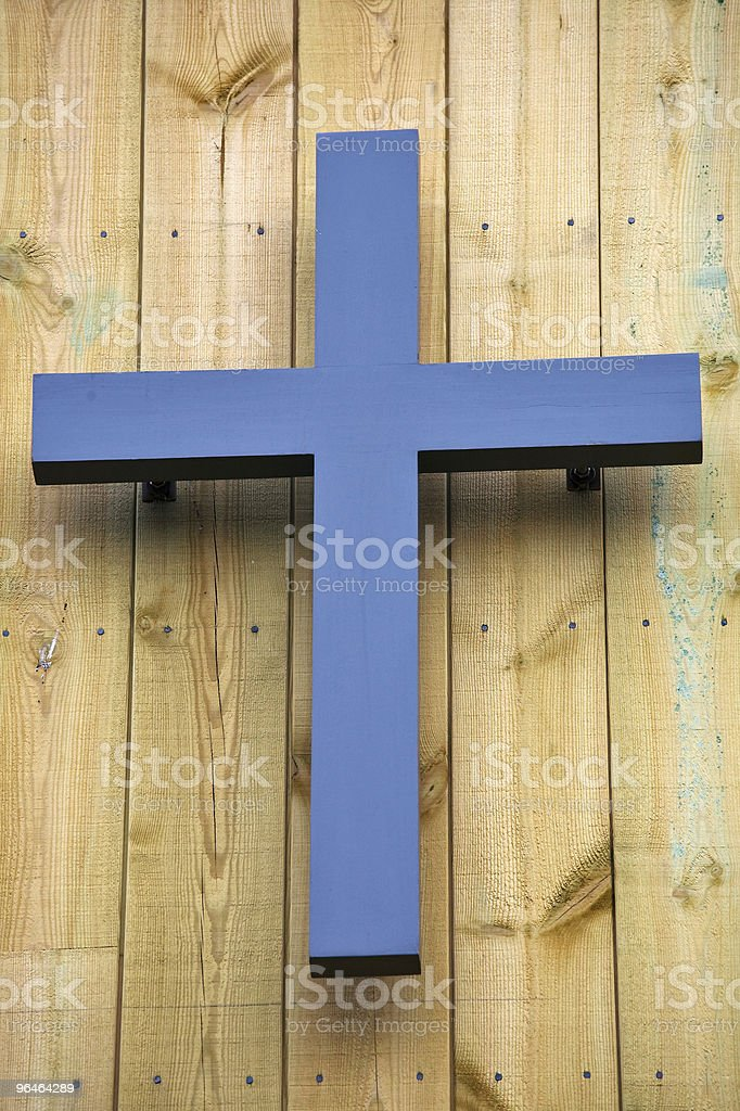 Cross hangs on a wooden wall royalty-free stock photo
