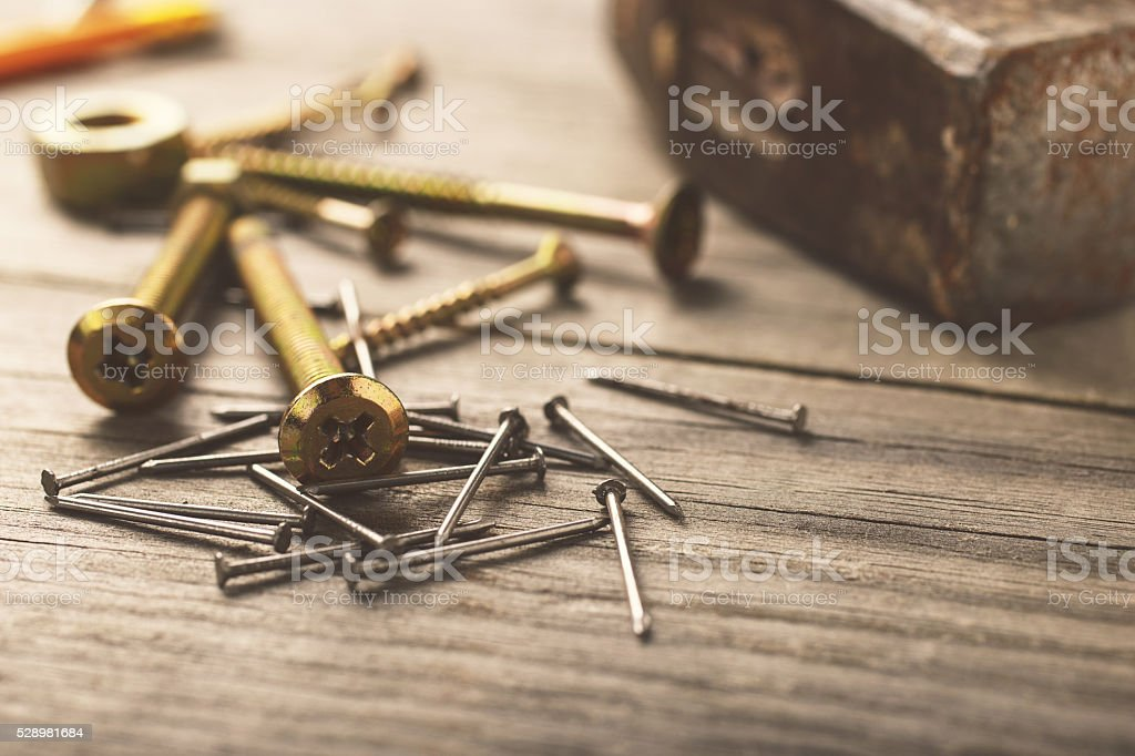 cross head bolt screws thread with nails and hammer stock photo