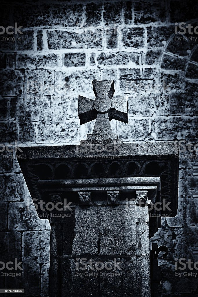 cross in a graveyard royalty-free stock photo