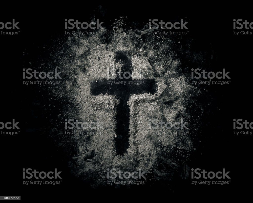 Cross in ashes stock photo