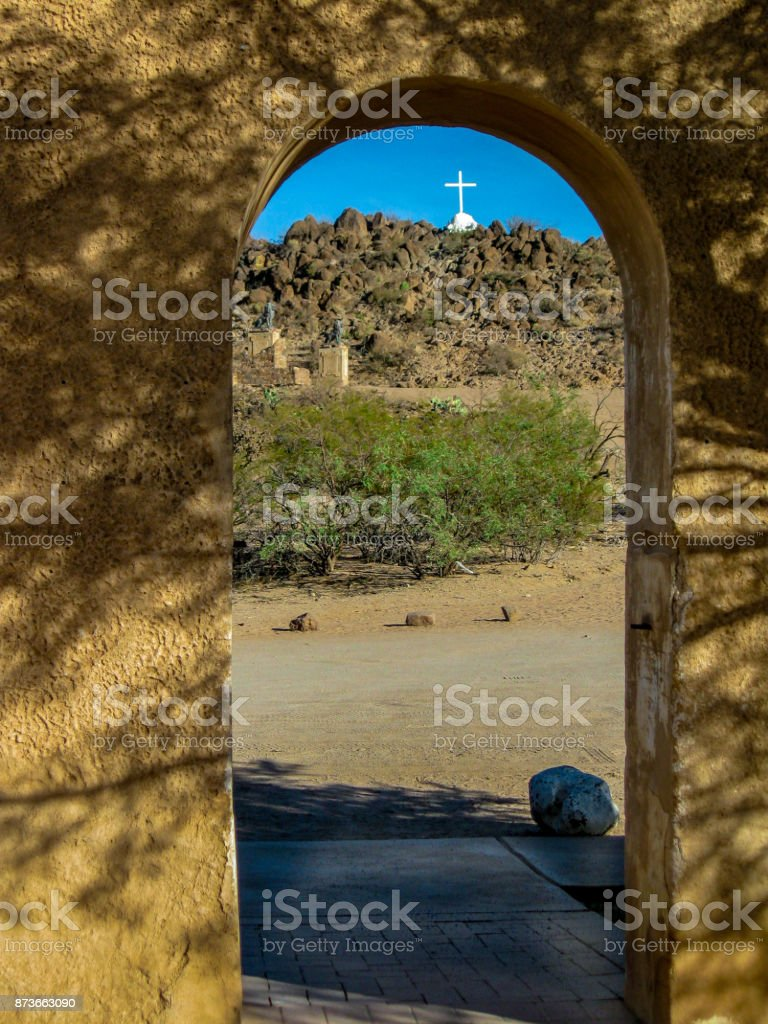 Cross in rustic chuch archway stock photo