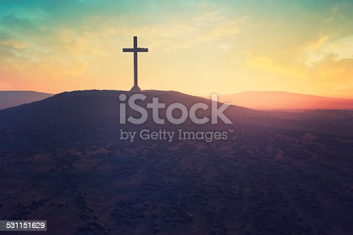 Cross in the middle of a desert.