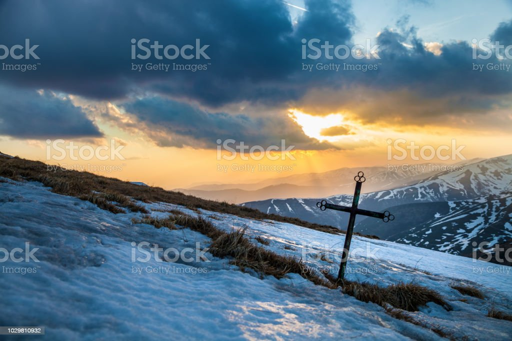 Cross in the mountains stock photo