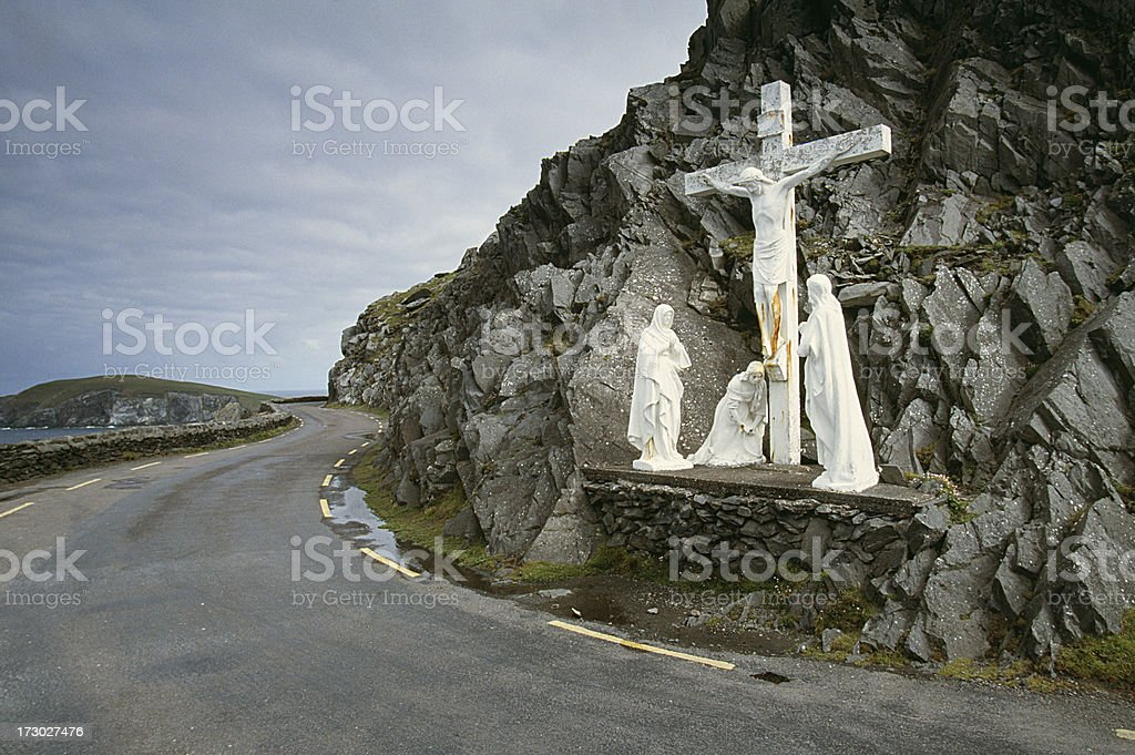 Cross in the road's curve royalty-free stock photo