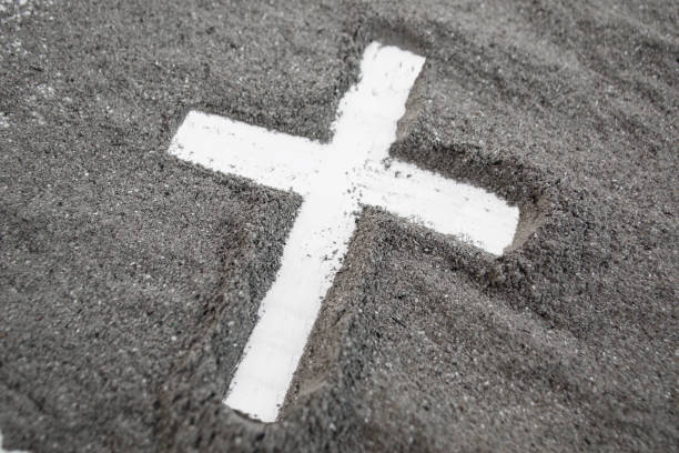cross made of ashes, ash wednesday, lent season vintage abstract background - ash cross stock photos and pictures