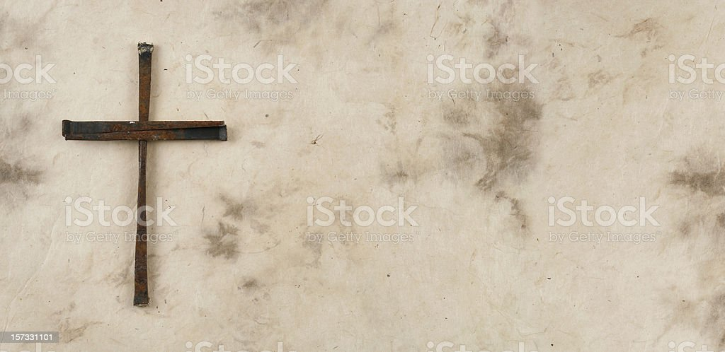 Cross Made of Rusty Nails on Grunge Background royalty-free stock photo
