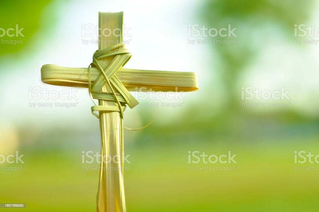 Cross made out of palm fronds. stock photo