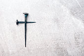 istock Cross made with rusty nails and drops of blood on grey background. Copy space. Good Friday, Easter day. Christian backdrop. Biblical faith, gospel, salvation concept. Crucifixion of Jesus Christ 1293749426