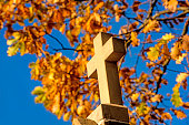istock cross of a pilgrim way with autumnal painted leaves 1069641776