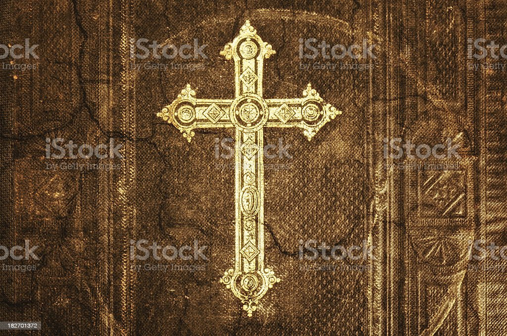 Cross of Christ on an old Bible royalty-free stock photo