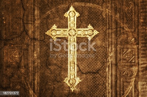 Close-up from cross of christ on an 100 years old Bible - Grunge Look