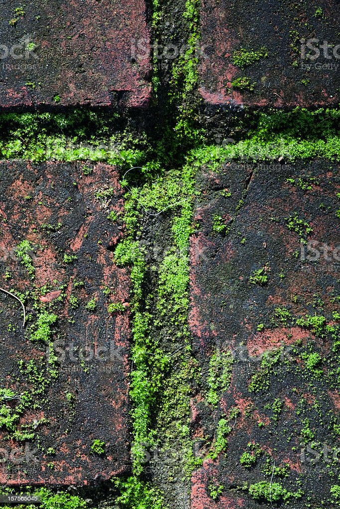 Cross of Moss and Brick royalty-free stock photo