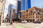 Seattle, Washington, USA - July 6, 2018: The crossroad of Pine street and the 3rd Avenue in the downtown of Seattle, Washington, USA
