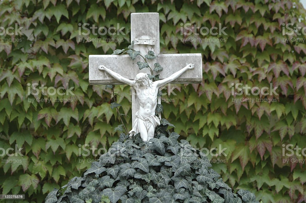 Cross on a grave stock photo