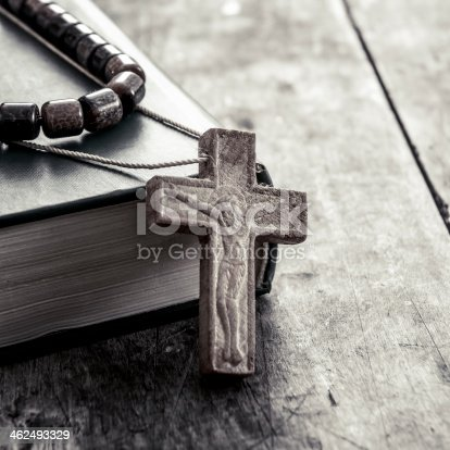 istock cross on a wooden surface closeup 462493329