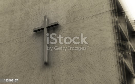 A cross on an apartment building wall in Hong Kong.