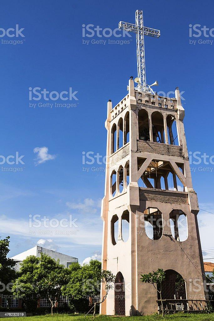 Cross on Belfry of Modern Christian Church Under Blue Sky stock photo