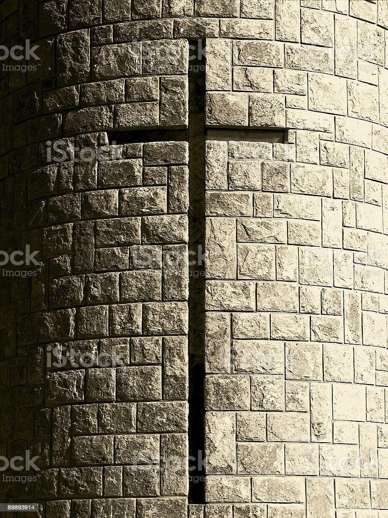 Cross on stone tower - monochrome royalty-free stock photo
