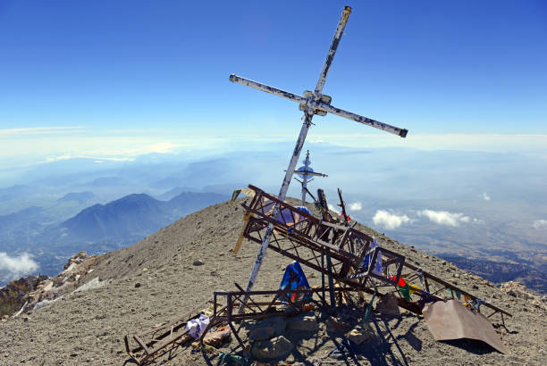 Cross on summit of Pico de Orizaba, Mexico high point Pico de Orizaba volcano, or Citlaltepetl, is the highest mountain in Mexico, maintains glaciers and is a popular peak to climb along with Iztaccihuatl and other volcanoes in the country. orizaba stock pictures, royalty-free photos & images