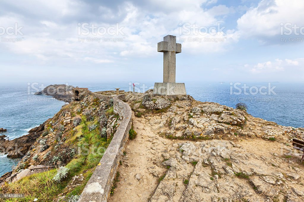 Cross on the cape Pointe du Decolle, France stock photo