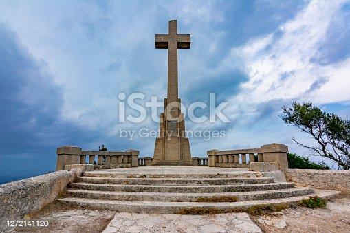 istock Cross on top of Sant Salvador mountain, Mallorca island, Spain 1272141120