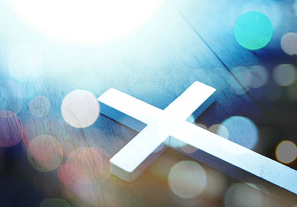 cross on wood and bokeh background - christianity stock photos and pictures
