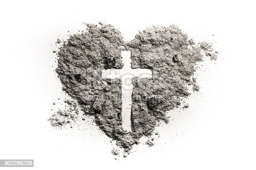 istock Cross or crucifix in heart symbol made of ash 902286206