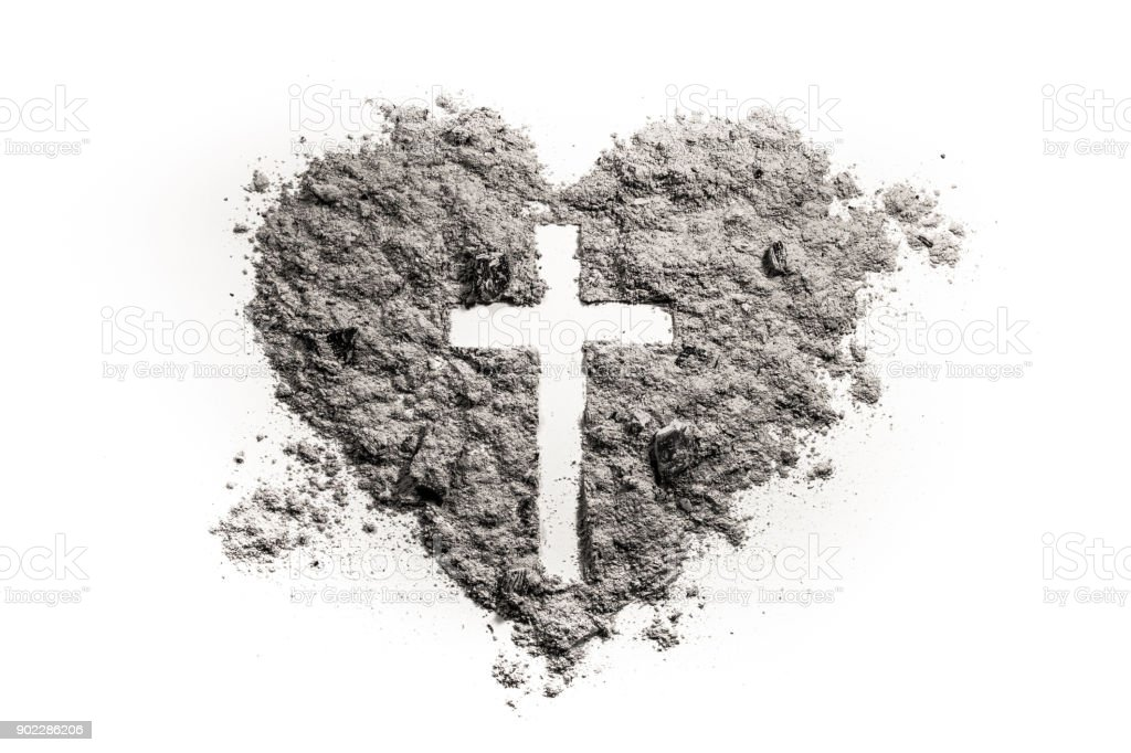 Cross or crucifix in heart symbol made of ash stock photo