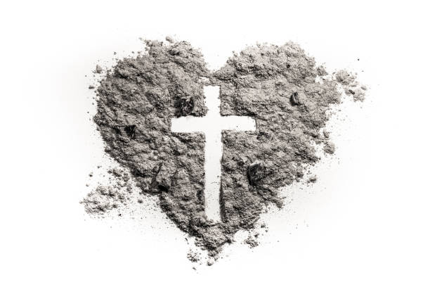 cross or crucifix in heart symbol made of ash - ash cross stock photos and pictures