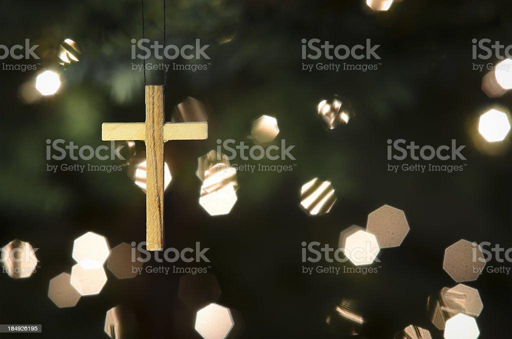 Cross Ornament on Christmas Tree stock photo