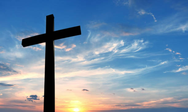 cross over bright sunset background - cross stock photos and pictures