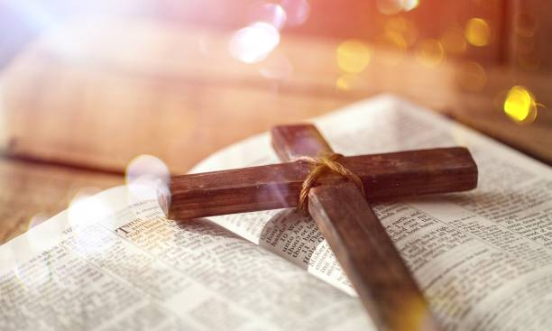 Cross. Holy Bible book and cross, close-up view catholicism stock pictures, royalty-free photos & images