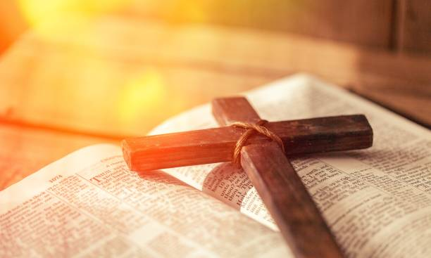 Cross. Holy Bible book and cross, close-up view religion stock pictures, royalty-free photos & images