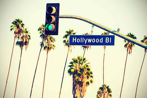 Cross processed Hollywood sign and traffic lights. stock photo