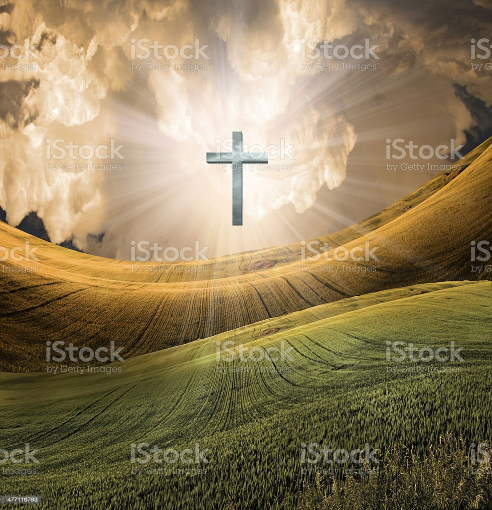 Cross radiates light in sky stock photo