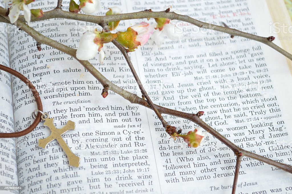 Cross, scripture, and flowers - closeup stock photo