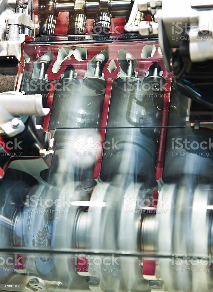 Cross section of a car engine with pistons in motion stock photo